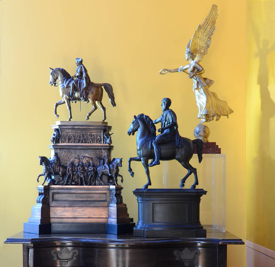 Three models with larger figures are Grand Tour souvenirs from Italy and Germany.