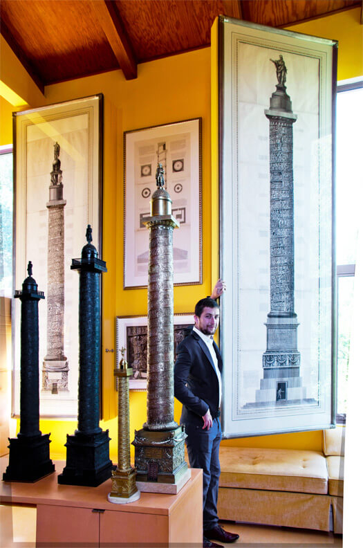 The Vendome Column was widely reproduced as the symbol of Napoleon's empire. Here three large bronze replicas of the Vendome Column are before two Piranesi prints of Rome's Trajan's and Antonine Columns.