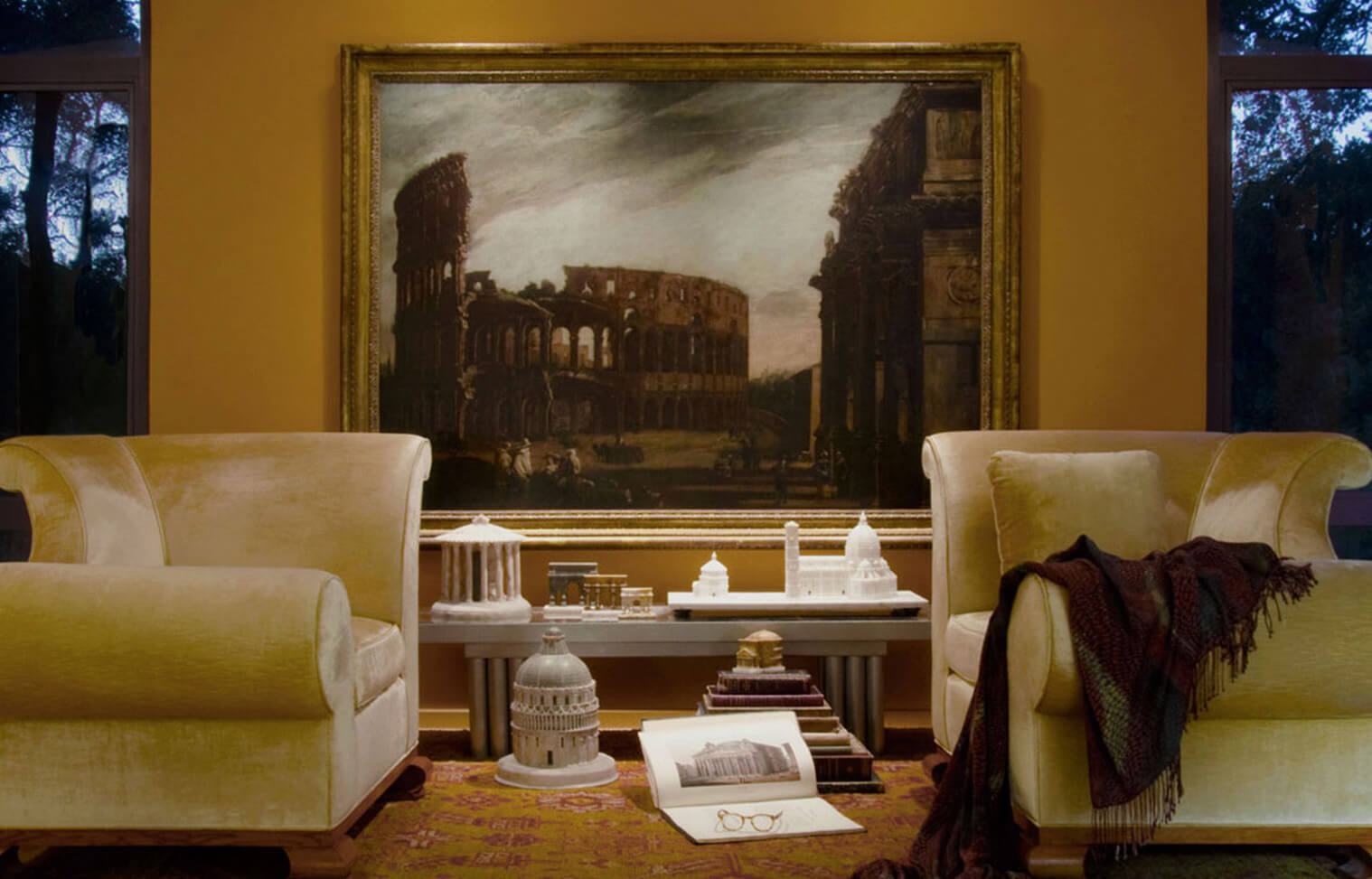 The Piraneseum Gallery extends to more domestic spaces, like this bedroom dominated by Codazzi's 17th Cenmtury View of the Colosseum in Rome.